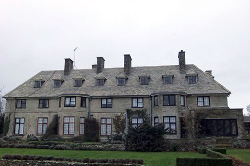 roofed house in winchcombe with imitation stone