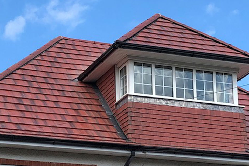 Finished roof with conversion window tiled