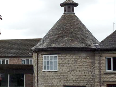 Rounded peak roof with pigeon tower
